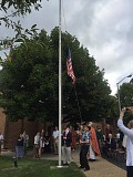 The lowering of the Flag before 'Taps' was played